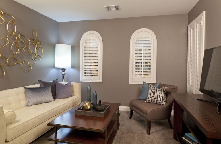 Southern California family room with rounded plantation shutters.